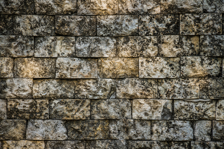 A background image consisting of aged and weathered grungy bricks with spots of sunlight on them. Stock Photo - 124522670