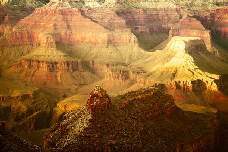 The colors of the many layers of the rock that forms the walls of the Grand Canyon.