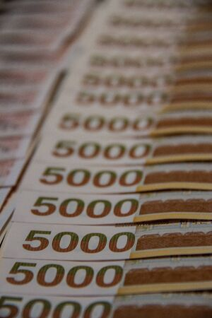 Close up of a lot of 5000 Republic of Korea Won currency neatly presented.
