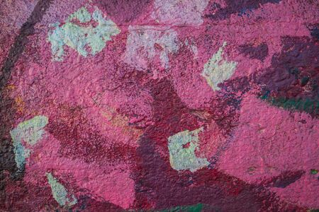 Abstract background in pink shades on a very rough and textured background.
