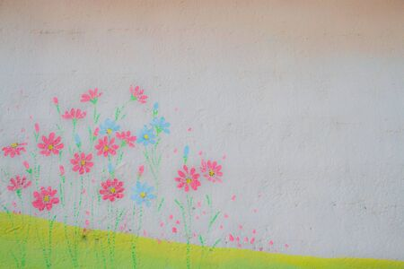 Bright spring flowers painted onto a concrete surface with a light texture.