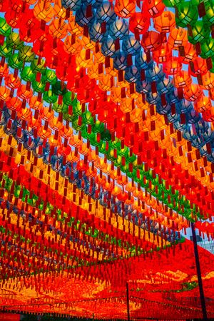 Rows and rows of colorful illuminated buddhist lotus lanterns hanging overhead at the . Jogyesa Buddhist temple in Seoul, South Korea.