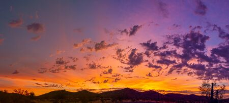 Sunrise panorama over the sonoran desert of Arizona with layers of mountains shot at altitude by a drone. Фото со стока