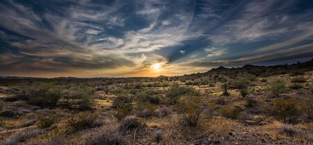 A sunset over the Sonoran Desert of Arizona with high altitude clouds panorama.