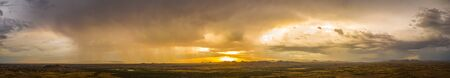A panorama of a monsoon at sunset over the Sonoran desert of Arizona. Stock fotó