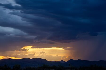 A sunset image of a monsoon in the Sonoran desert of Arizona. Stock fotó