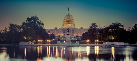 Panoramic image of the Capitol of the United States with the capitol reflecting pool in morning light. Stock Photo