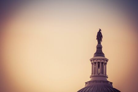 The Statue of Freedom on top of the dome of the United States Capitol in morning light.