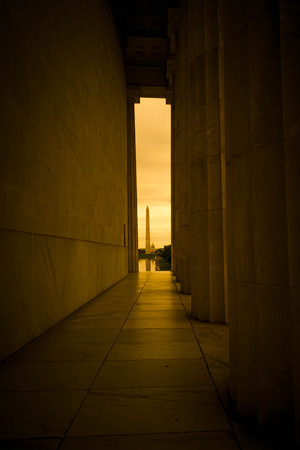 The Washington Monument framed in the distance through the architecture of the Lincoln Memorial. Editorial