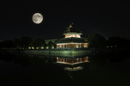 watchtower: The watchtower of the Forbidden City under the moon light in Beijing, China