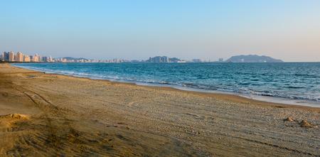 and sanya: The Sanya bay beach under the sunset.