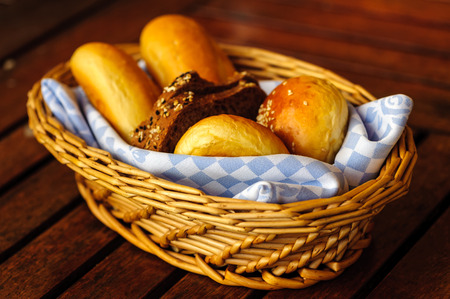 bread basket: Various breads in basket on a table. Stock Photo