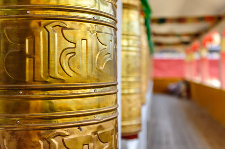 Prayer wheels of Lharong Monastery in Sertar, Tibet.  Lharong Monastery is a Tibetan Buddhist Institute at an elevation of about 4000 meters.