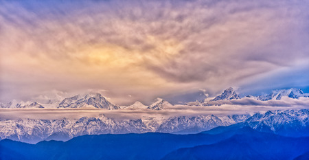 sichuan province: Minya Konka snow mountain with the clouds sea under the sunrise in Niubei mountain of Sichuan province of China. Stock Photo