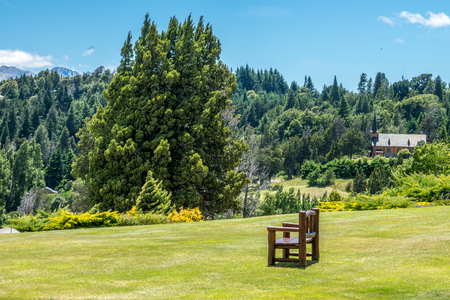 A chair on the lawns at the Llao Llao village in Bariloche, Argentina.