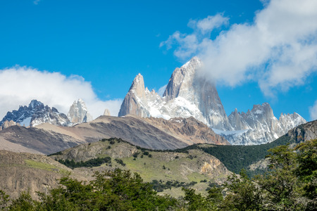 roy: Fitz Roy is a mountain located near El Chalten village, in the Southern Patagonian Ice Field in Patagonia, on the border between Argentina and Chile. Stock Photo