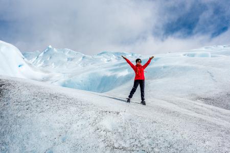 standing on the Perito Moreno Glacier in the Los Glaciares National Park, Patagonia, Argentina.