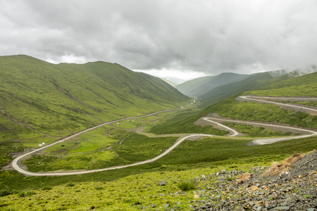 The winding road (sktline) on the moutain near the Lharong Monastery in Sertar, Sichuan province.
