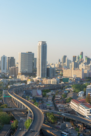interchanged: Beautiful skyline of Bangkok City downtown and road interchanged after sunset Stock Photo