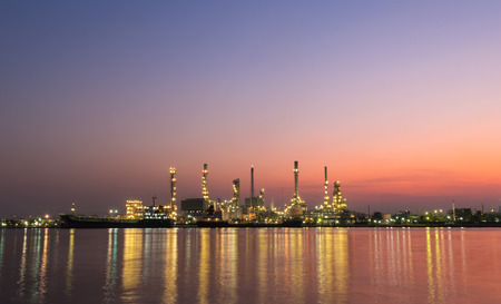gas refinery: oil refinery industry plant along twilight morning