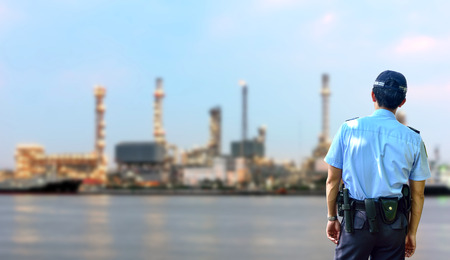 environment protection: Security guard Oil refinery at twilight - petrochemical industry