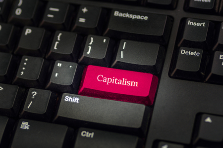 capitalism: Close-up view on conceptual keyboard - Capitalism