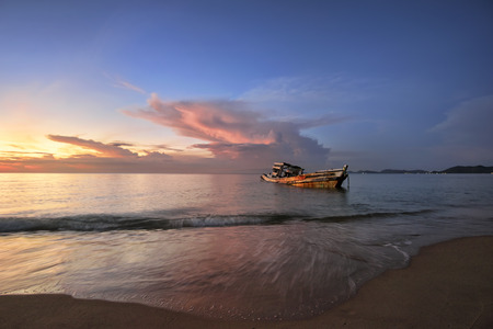 ship Wreck fishing boat on the beach at sunrise