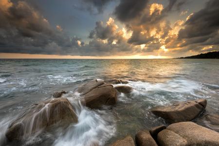 beautiful landscape wave hit rock at sunset Stok Fotoğraf