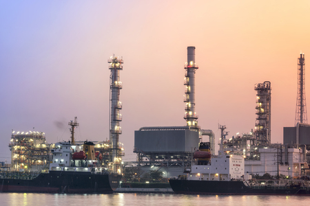 oil Refinery industry at Twilight and fog