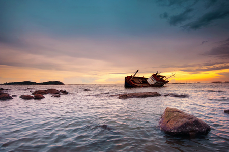 old shipwreck or wrecked boat abandoned stand on beach