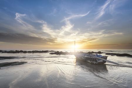 sunset near a village of fishermen