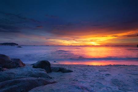 Colorful sunset over ocean on beach