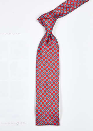 Red and white silk tie with white background Stock Photo