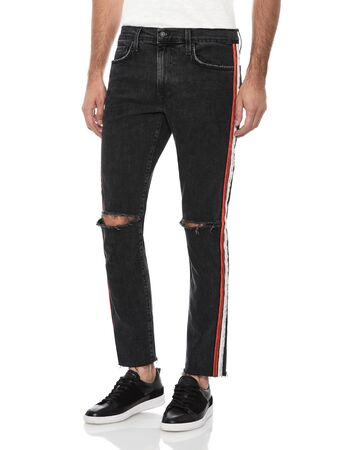 Casual Black slim fit men denim with sneakers with white background, Classic men white T-shirt with striped knee cut trouser paired with black sneakers with white background.. Reklamní fotografie