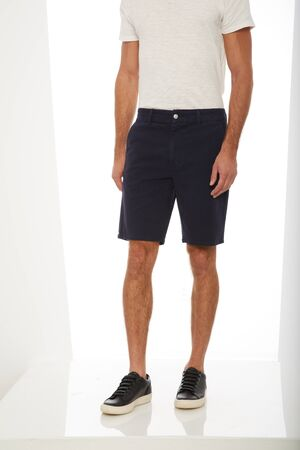 Plain white casual T-shirt carried along blue denim shorts and white sneakers with white background, Blue denim ripped shorts for men's paired with white tank top and black footwear with white background Stock fotó