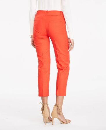 Blue formal pants for women's paired with orange full sleeve T-Shirt and flat footwear with white background, Blue formal pants for women's paired with orange full sleeve T-Shirt and flat footwear with white background