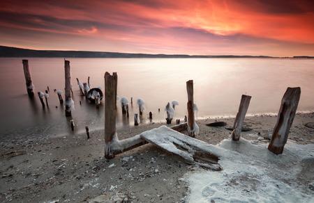 Wonderful winter sunset on a lake  photo
