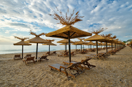 sunshades: Beach with wooden sunshades in the morning Stock Photo