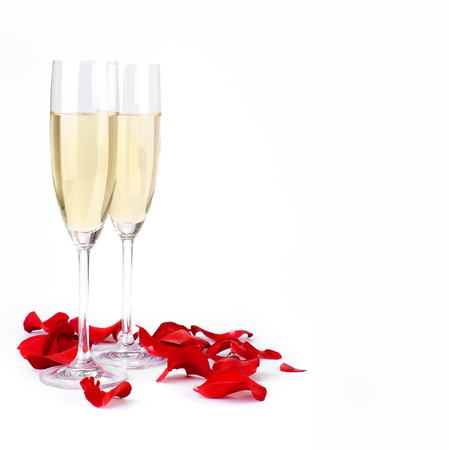 Decoration with rose petals and champagne on a white photo