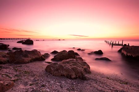 Beautiful sea sunrise in gentle pink tones  Фото со стока