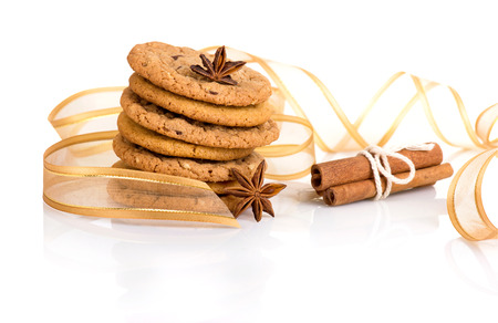 Spices and cookies isolated on white photo