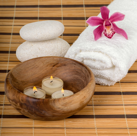 Spa decoration with candles, orchid and spa stones photo