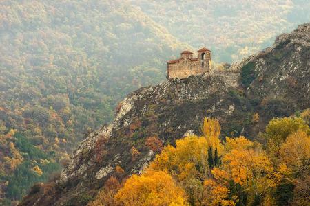 Autumn landscape with the church at Asen s Fortress near Asenovgrad, Bulgaria Фото со стока