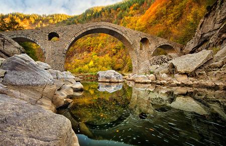Autumn view with an old bridge, Bulgaria Reklamní fotografie