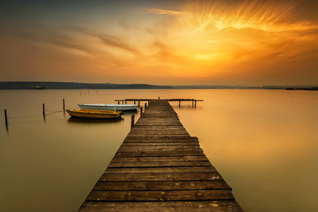 Sunset view with boats at a lake coast near Varna, Bulgaria