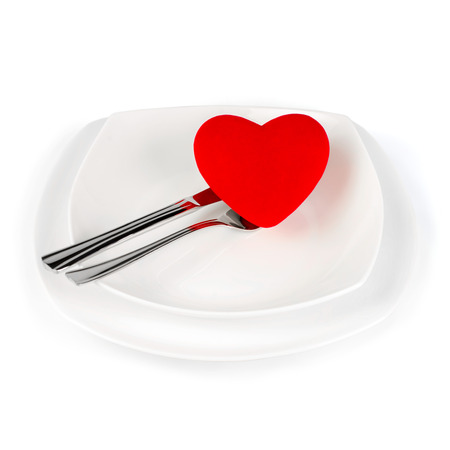 Red Heart shape on a white plate  photo