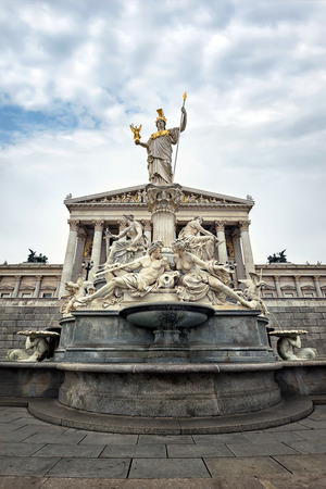 neo classical: The Pallas-Athene Fountain in front of the Neo-Classic temple of parliament government in Vienna, Austria Stock Photo