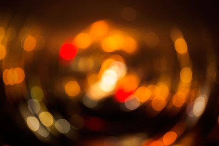 distorted image: Highly defocused street lights in different color and blur effect