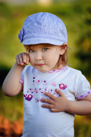 Close up portrait of cute little girl crying photo