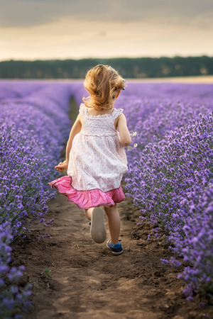 Among the lavender fields. Beautiful little girl on the background of a lavender field, Bulgaria.